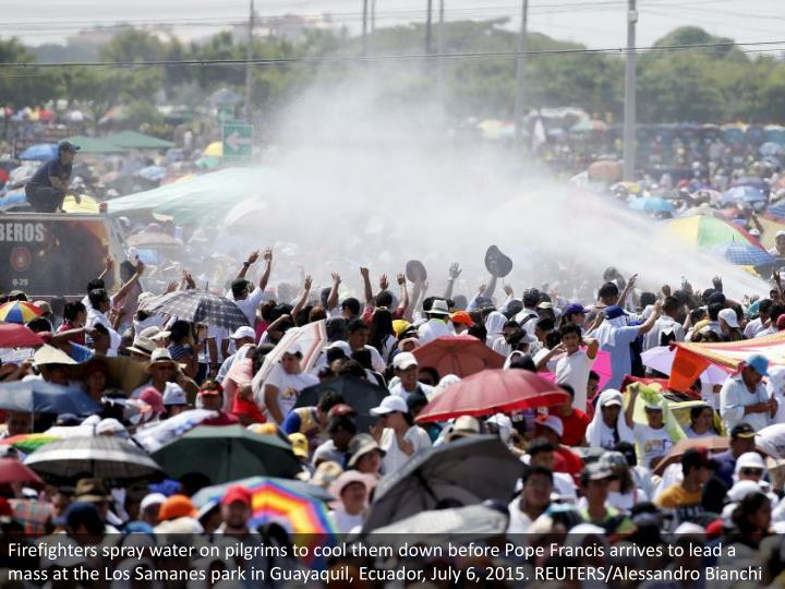 Firefighters spray water on pilgrims to cool them down before Pope Francis arrives to lead a mass at the Los Samanes park in Guayaquil, Ecuador, July 6, 2015. REUTERS/Alessandro Bianchi