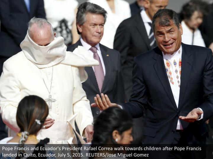 Pope Francis and Ecuador's President Rafael Correa walk towards children after Pope Francis landed in Quito, Ecuador, July 5, 2015. REUTERS/Jose Miguel Gomez