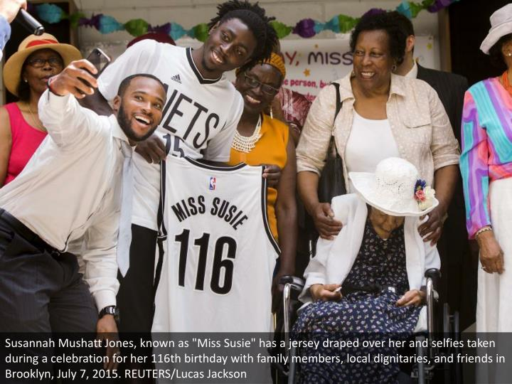 """Susannah Mushatt Jones, known as """"Miss Susie"""" has a jersey draped over her and selfies taken during a celebration for her 116th birthday with family members, local dignitaries, and friends in Brooklyn, July 7, 2015. REUTERS/Lucas Jackson"""