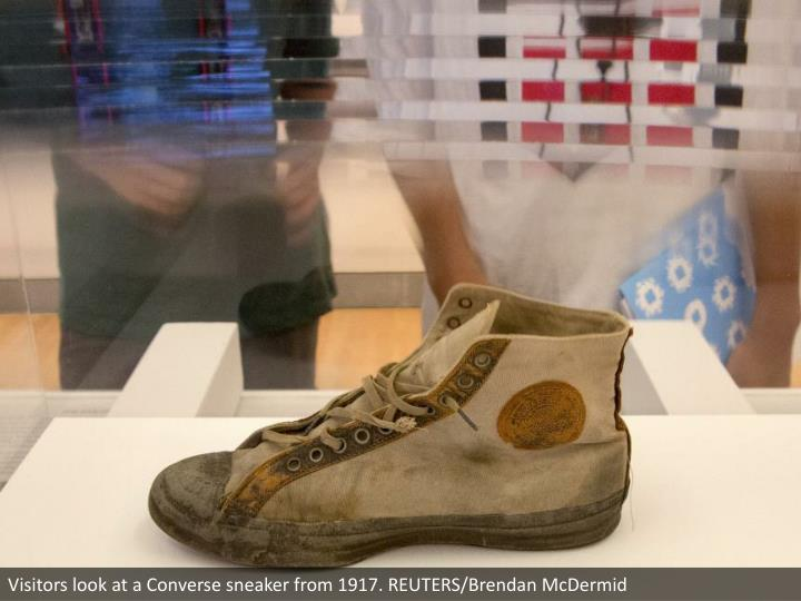 Visitors look at a Converse sneaker from 1917. REUTERS/Brendan McDermid