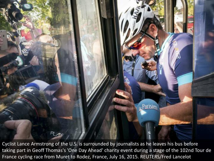 Cyclist Lance Armstrong of the U.S. is surrounded by journalists as he leaves his bus before taking part in Geoff Thomas's 'One Day Ahead' charity event during a stage of the 102nd Tour de France cycling race from Muret to Rodez, France, July 16, 2015. REUTERS/Fred Lancelot