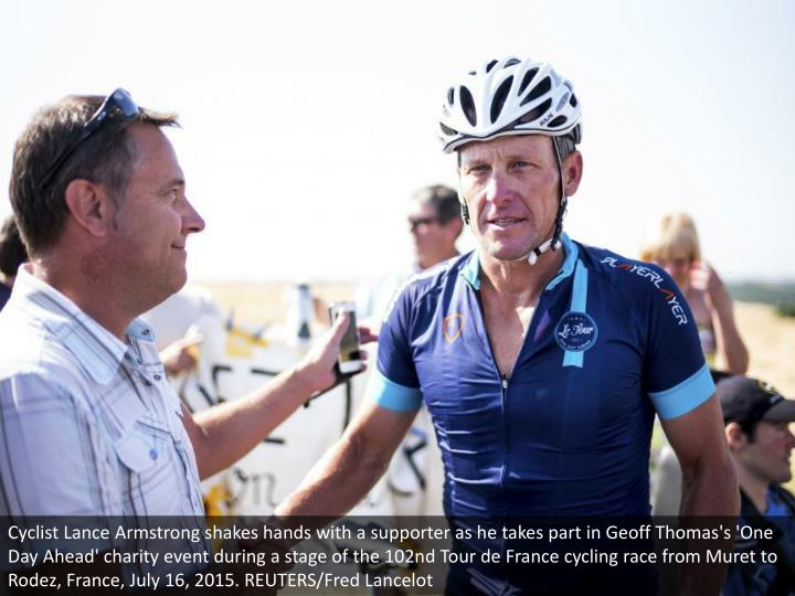 Cyclist Lance Armstrong shakes hands with a supporter as he takes part in Geoff Thomas's 'One Day Ahead' charity event during a stage of the 102nd Tour de France cycling race from Muret to Rodez, France, July 16, 2015. REUTERS/Fred Lancelot