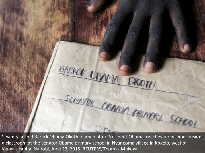 Seven-year-old Barack Obama Okoth, named after President Obama, reaches for his book inside a classroom at the Senator Obama primary school in Nyangoma village in Kogelo, west of Kenya's capital Nairobi, June 23, 2015. REUTERS/Thomas Mukoya