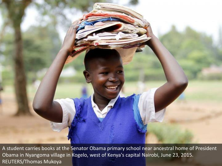A student carries books at the Senator Obama primary school near ancestral home of President Obama in Nyangoma village in Kogelo, west of Kenya's capital Nairobi, June 23, 2015. REUTERS/Thomas Mukoya