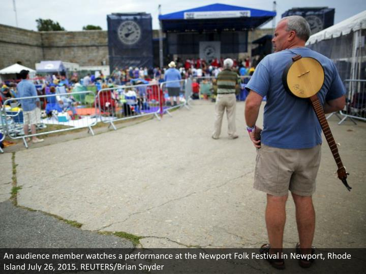 An audience member watches a performance at the Newport Folk Festival in Newport, Rhode Island July 26, 2015. REUTERS/Brian Snyder