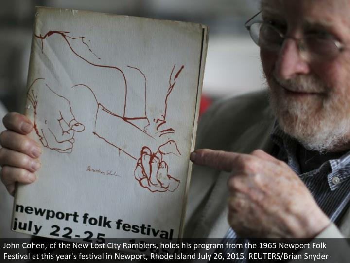 John Cohen, of the New Lost City Ramblers, holds his program from the 1965 Newport Folk Festival at this year's festival in Newport, Rhode Island July 26, 2015. REUTERS/Brian Snyder