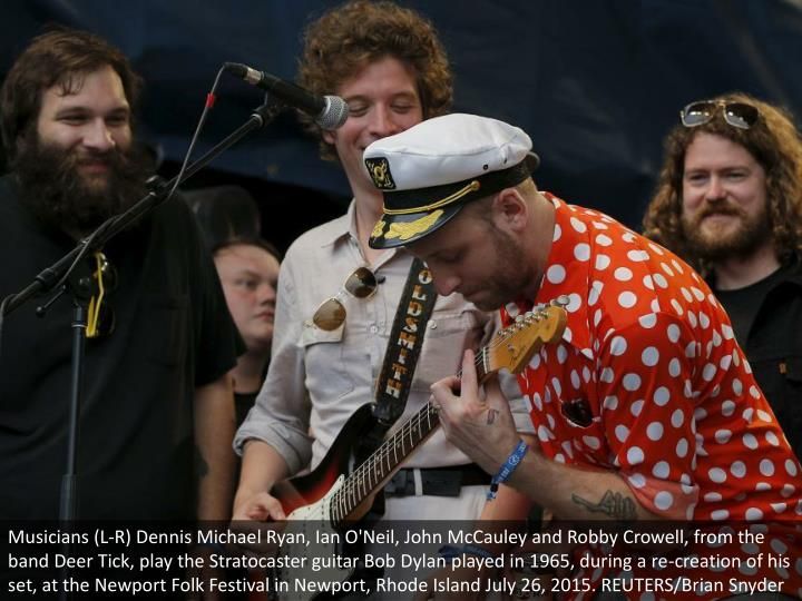 Musicians (L-R) Dennis Michael Ryan, Ian O'Neil, John McCauley and Robby Crowell, from the band Deer Tick, play the Stratocaster guitar Bob Dylan played in 1965, during a re-creation of his set, at the Newport Folk Festival in Newport, Rhode Island July 26, 2015. REUTERS/Brian Snyder