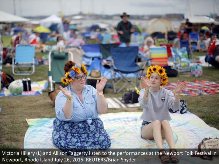 Victoria Hillery (L) and Allison Taggerty listen to the performances at the Newport Folk Festival in Newport, Rhode Island July 26, 2015. REUTERS/Brian Snyder