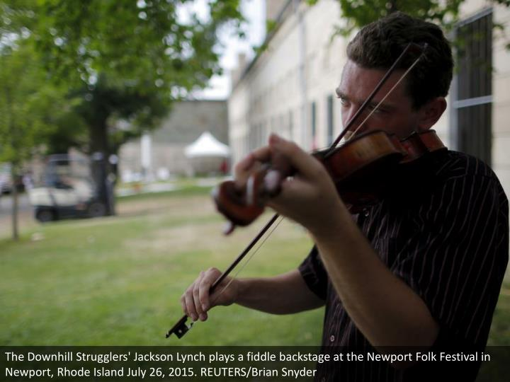 The Downhill Strugglers' Jackson Lynch plays a fiddle backstage at the Newport Folk Festival in Newport, Rhode Island July 26, 2015. REUTERS/Brian Snyder