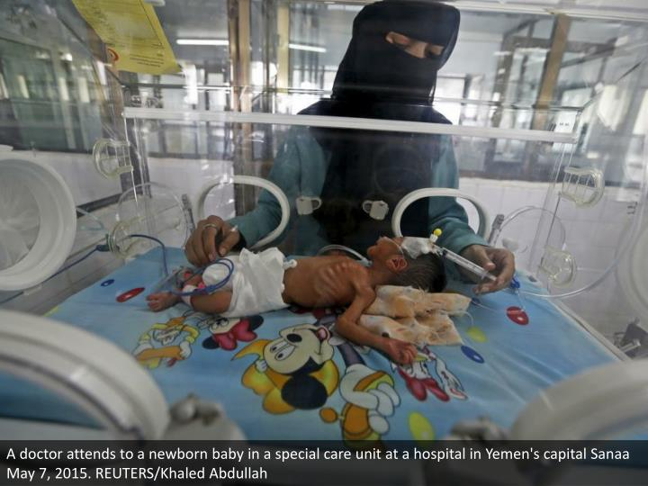 A doctor attends to a newborn baby in a special care unit at a hospital in Yemen's capital Sanaa May 7, 2015. REUTERS/Khaled Abdullah