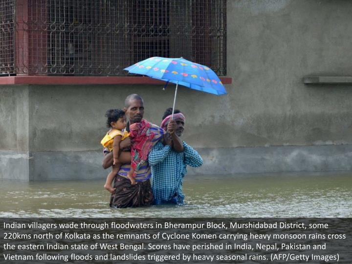 Indian villagers wade through floodwaters in Bherampur Block, Murshidabad District, some 220kms north of Kolkata as the remnants of Cyclone Komen carrying heavy monsoon rains cross the eastern Indian state of West Bengal. Scores have perished in India, Nepal, Pakistan and Vietnam following floods and landslides triggered by heavy seasonal rains. (AFP/Getty Images)