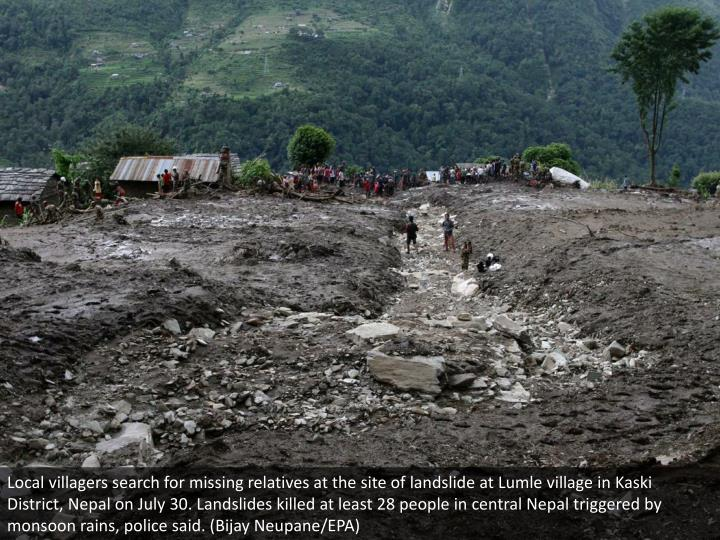 Local villagers search for missing relatives at the site of landslide at Lumle village in Kaski District, Nepal on July 30. Landslides killed at least 28 people in central Nepal triggered by monsoon rains, police said. (Bijay Neupane/EPA)