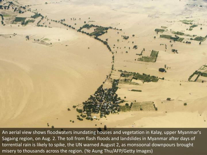 An aerial view shows floodwaters inundating houses and vegetation in Kalay, upper Myanmar's Sagaing ...