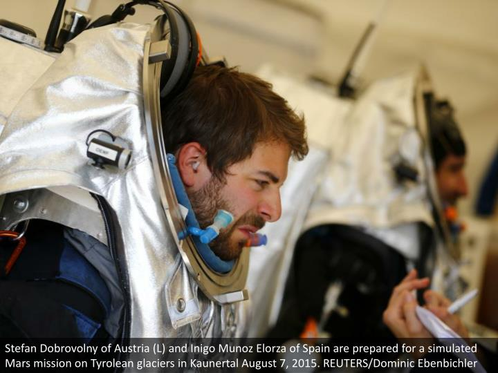 Stefan Dobrovolny of Austria (L) and Inigo Munoz Elorza of Spain are prepared for a simulated Mars mission on Tyrolean glaciers in Kaunertal August 7, 2015. REUTERS/Dominic Ebenbichler