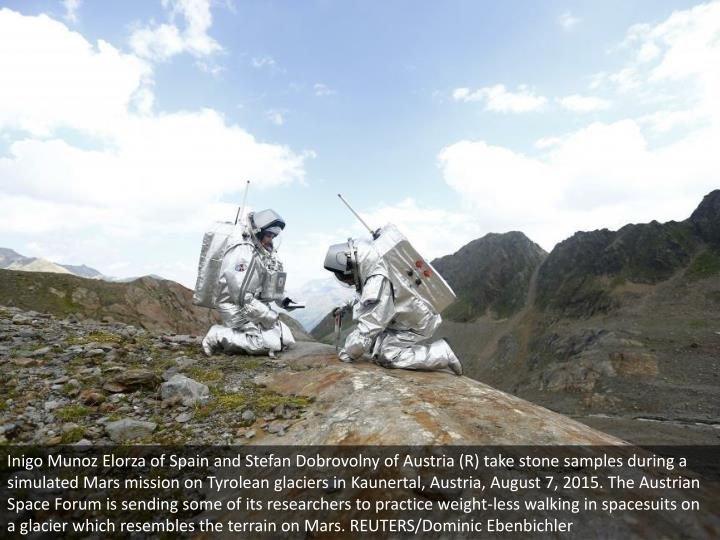 Inigo Munoz Elorza of Spain and Stefan Dobrovolny of Austria (R) take stone samples during a simulated Mars mission on Tyrolean glaciers in Kaunertal, Austria, August 7, 2015. The Austrian Space Forum is sending some of its researchers to practice weight-less walking in spacesuits on a glacier which resembles the terrain on Mars. REUTERS/Dominic Ebenbichler