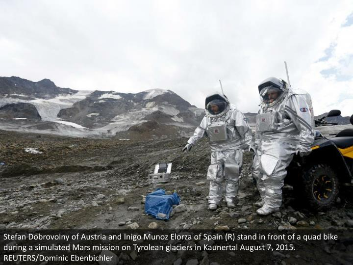 Stefan Dobrovolny of Austria and Inigo Munoz Elorza of Spain (R) stand in front of a quad bike during a simulated Mars mission on Tyrolean glaciers in Kaunertal August 7, 2015. REUTERS/Dominic Ebenbichler