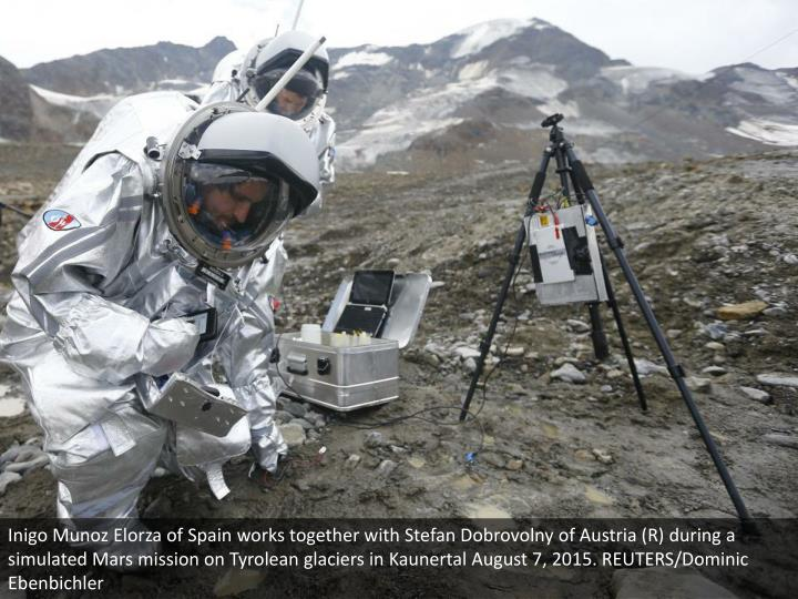 Inigo Munoz Elorza of Spain works together with Stefan Dobrovolny of Austria (R) during a simulated Mars mission on Tyrolean glaciers in Kaunertal August 7, 2015. REUTERS/Dominic Ebenbichler