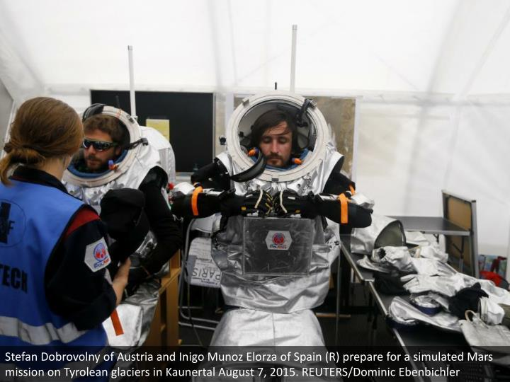 Stefan Dobrovolny of Austria and Inigo Munoz Elorza of Spain (R) prepare for a simulated Mars mission on Tyrolean glaciers in Kaunertal August 7, 2015. REUTERS/Dominic Ebenbichler