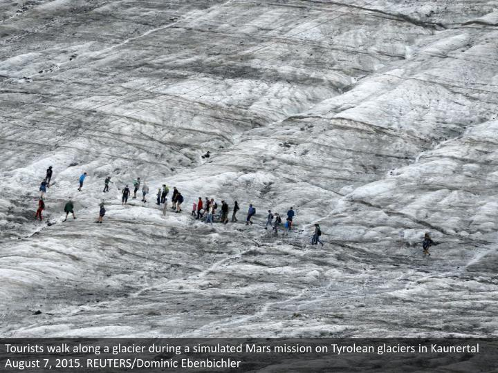 Tourists walk along a glacier during a simulated Mars mission on Tyrolean glaciers in Kaunertal August 7, 2015. REUTERS/Dominic Ebenbichler