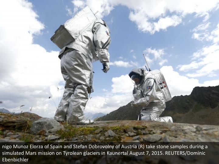 nigo Munoz Elorza of Spain and Stefan Dobrovolny of Austria (R) take stone samples during a simulated Mars mission on Tyrolean glaciers in Kaunertal August 7, 2015. REUTERS/Dominic Ebenbichler