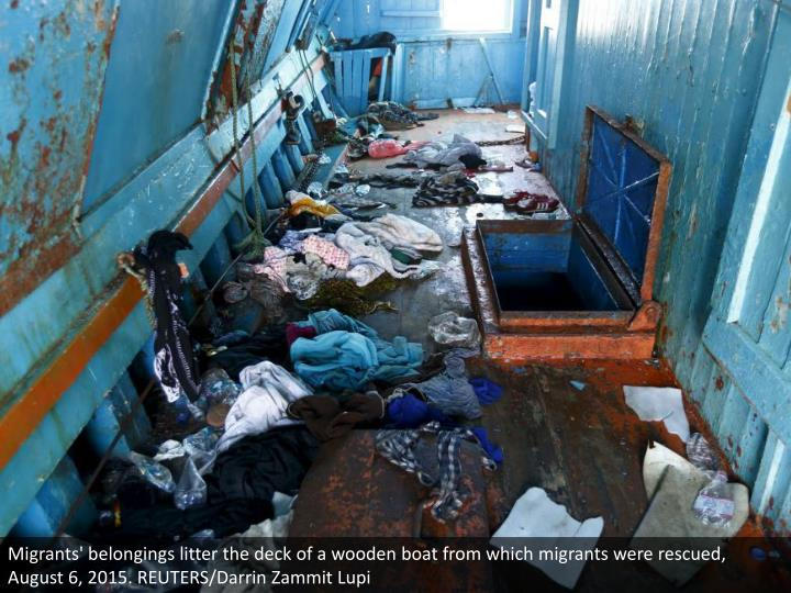 Migrants' belongings litter the deck of a wooden boat from which migrants were rescued, August 6, 2015. REUTERS/Darrin Zammit Lupi