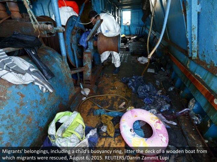 Migrants' belongings, including a child's buoyancy ring, litter the deck of a wooden boat from which migrants were rescued, August 6, 2015. REUTERS/Darrin Zammit Lupi