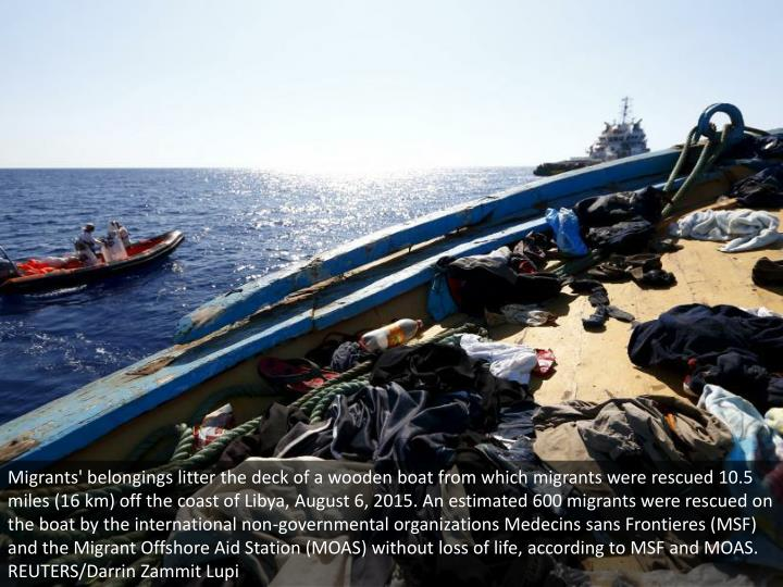 Migrants' belongings litter the deck of a wooden boat from which migrants were rescued 10.5 miles (1...