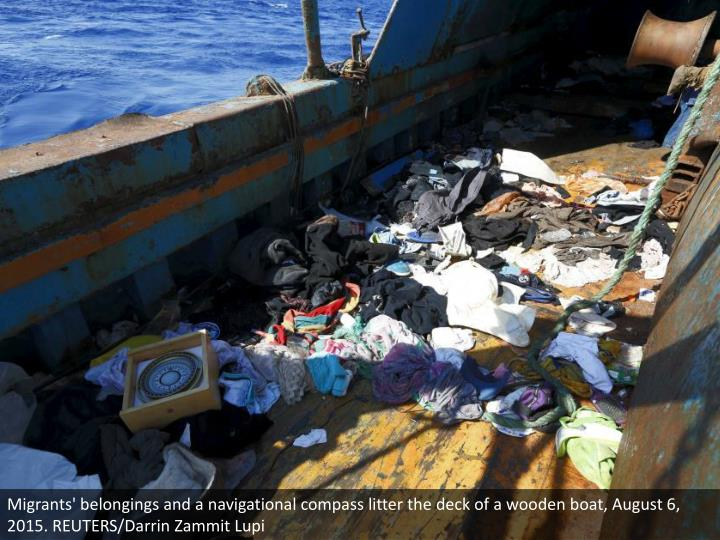 Migrants' belongings and a navigational compass litter the deck of a wooden boat, August 6, 2015. REUTERS/Darrin Zammit Lupi