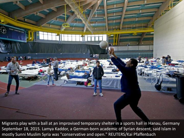 "Migrants play with a ball at an improvised temporary shelter in a sports hall in Hanau, Germany September 18, 2015. Lamya Kaddor, a German-born academic of Syrian descent, said Islam in mostly Sunni Muslim Syria was ""conservative and open."" REUTERS/Kai Pfaffenbach"