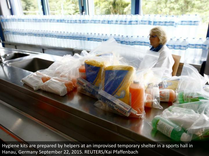 Hygiene kits are prepared by helpers at an improvised temporary shelter in a sports hall in Hanau, Germany September 22, 2015. REUTERS/Kai Pfaffenbach