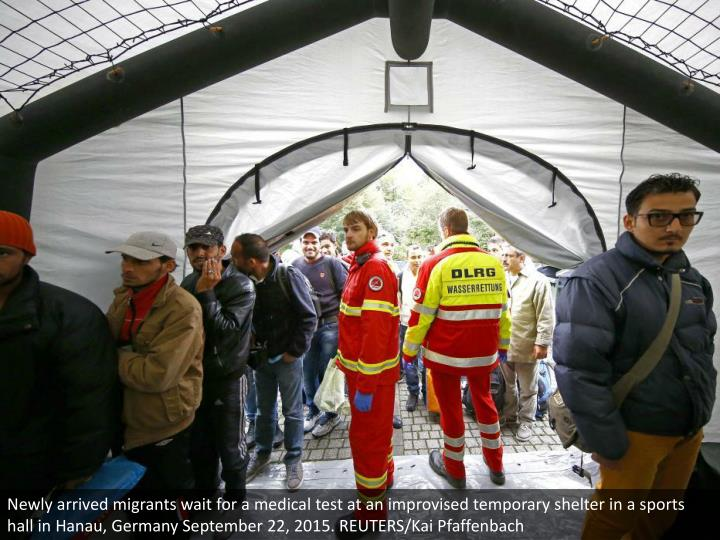 Newly arrived migrants wait for a medical test at an improvised temporary shelter in a sports hall in Hanau, Germany September 22, 2015. REUTERS/Kai Pfaffenbach