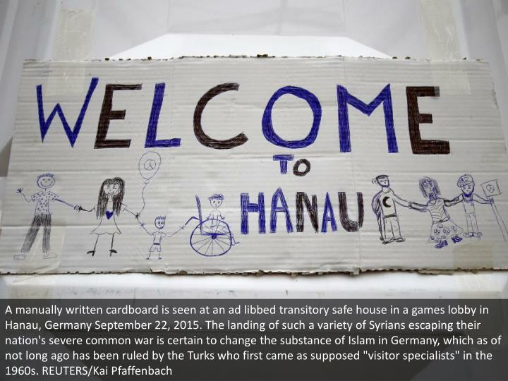 A manually written cardboard is seen at an ad libbed transitory safe house in a games lobby in Hanau...