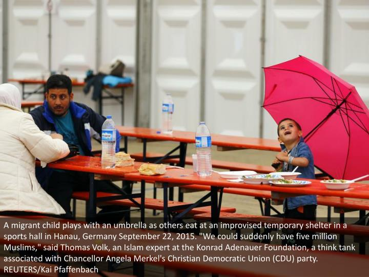 "A migrant child plays with an umbrella as others eat at an improvised temporary shelter in a sports hall in Hanau, Germany September 22, 2015. ""We could suddenly have five million Muslims,"" said Thomas Volk, an Islam expert at the Konrad Adenauer Foundation, a think tank associated with Chancellor Angela Merkel's Christian Democratic Union (CDU) party. REUTERS/Kai Pfaffenbach"
