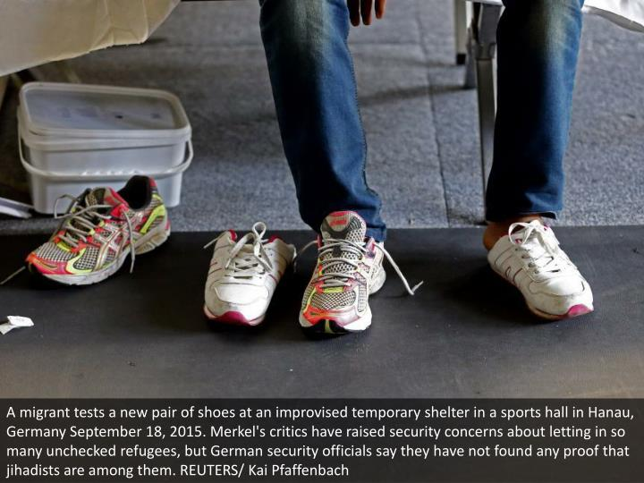 A migrant tests a new pair of shoes at an improvised temporary shelter in a sports hall in Hanau, Germany September 18, 2015. Merkel's critics have raised security concerns about letting in so many unchecked refugees, but German security officials say they have not found any proof that jihadists are among them. REUTERS/ Kai Pfaffenbach