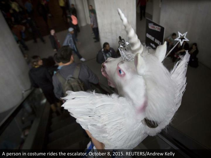 A person in costume rides the escalator, October 8, 2015. REUTERS/Andrew Kelly