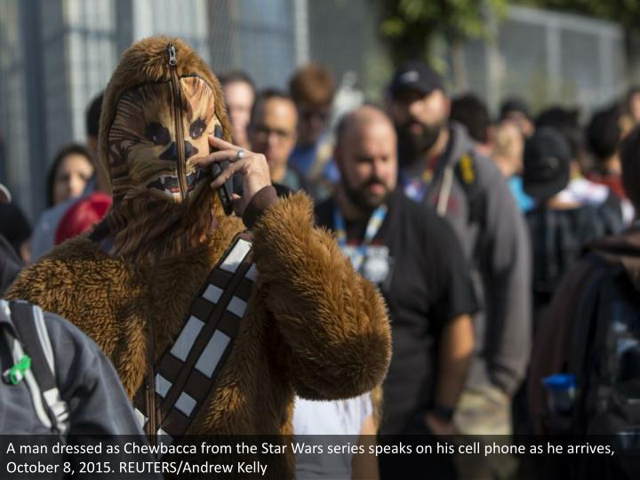 A man dressed as Chewbacca from the Star Wars series speaks on his cell phone as he arrives, October 8, 2015. REUTERS/Andrew Kelly