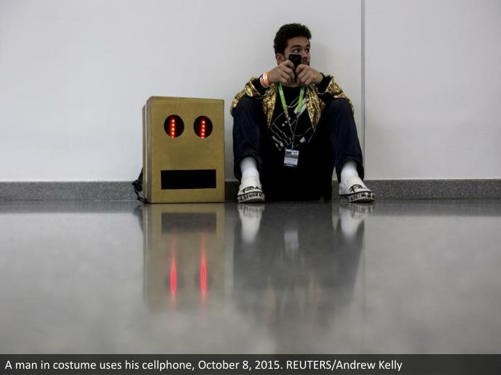 A man in costume uses his cellphone, October 8, 2015. REUTERS/Andrew Kelly