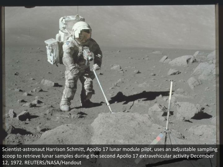 Scientist-astronaut Harrison Schmitt, Apollo 17 lunar module pilot, uses an adjustable sampling scoop to retrieve lunar samples during the second Apollo 17 extravehicular activity December 12, 1972. REUTERS/NASA/Handout