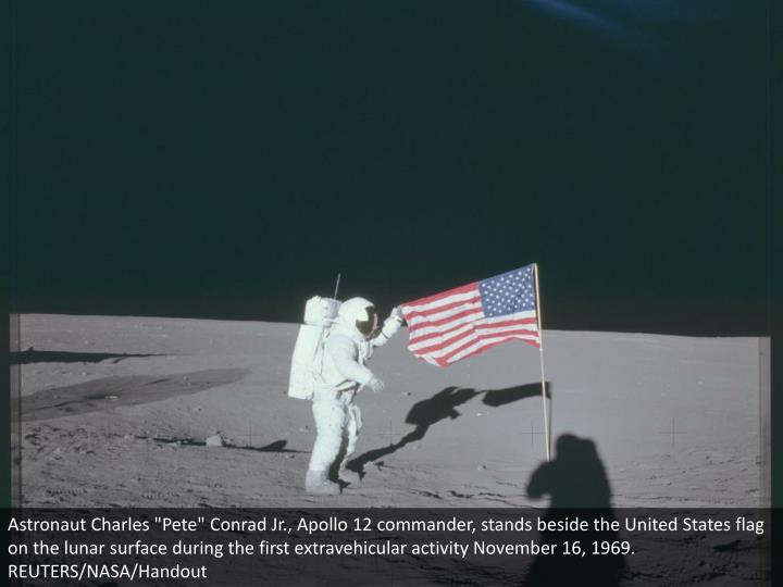 "Astronaut Charles ""Pete"" Conrad Jr., Apollo 12 commander, stands beside the United States flag on th..."