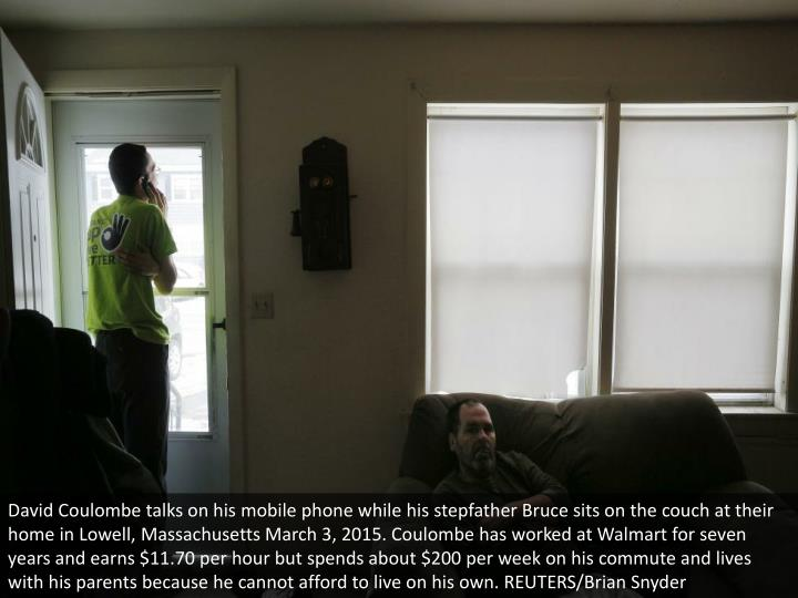 David Coulombe talks on his mobile phone while his stepfather Bruce sits on the couch at their home in Lowell, Massachusetts March 3, 2015. Coulombe has worked at Walmart for seven years and earns $11.70 per hour but spends about $200 per week on his commute and lives with his parents because he cannot afford to live on his own. REUTERS/Brian Snyder