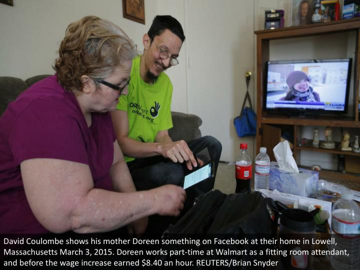 David Coulombe shows his mother Doreen something on Facebook at their home in Lowell, Massachusetts March 3, 2015. Doreen works part-time at Walmart as a fitting room attendant, and before the wage increase earned $8.40 an hour. REUTERS/Brian Snyder