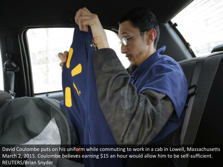 David Coulombe puts on his uniform while commuting to work in a cab in Lowell, Massachusetts March 2, 2015. Coulombe believes earning $15 an hour would allow him to be self-sufficient. REUTERS/Brian Snyder