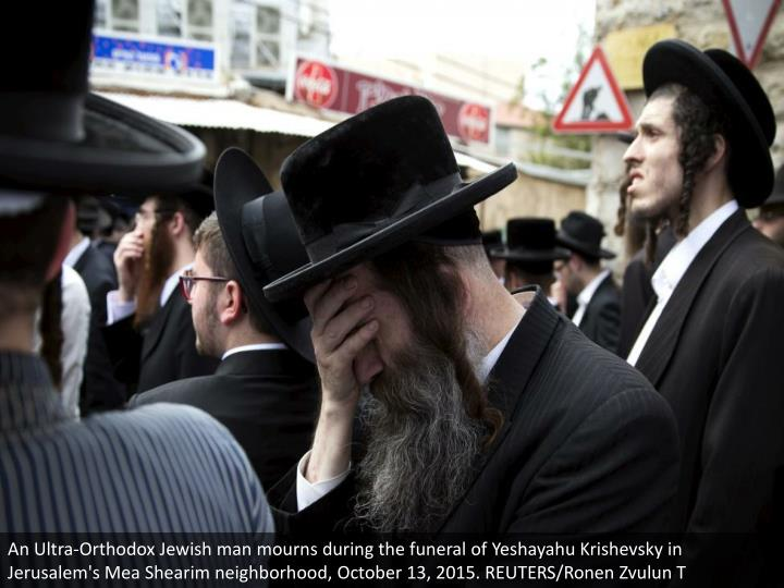 An Ultra-Orthodox Jewish man mourns during the funeral of Yeshayahu Krishevsky in Jerusalem's Mea Shearim neighborhood, October 13, 2015. REUTERS/Ronen Zvulun T