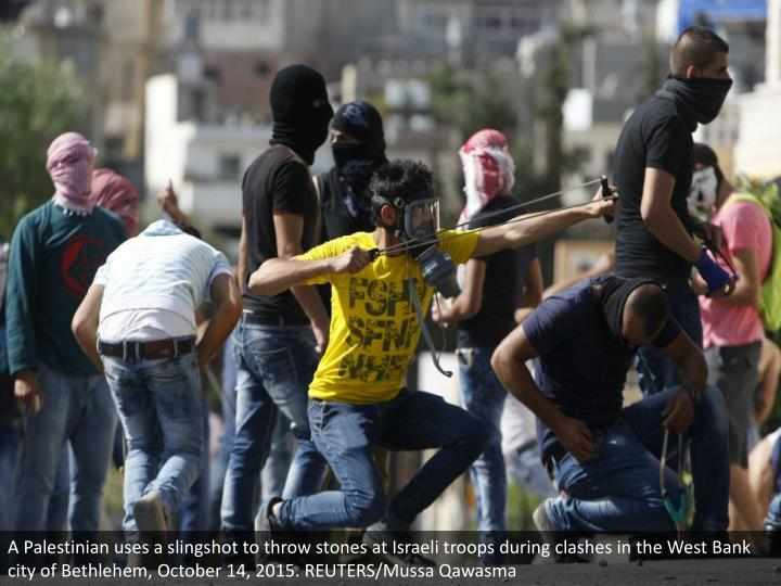 A Palestinian uses a slingshot to throw stones at Israeli troops during clashes in the West Bank city of Bethlehem, October 14, 2015. REUTERS/Mussa Qawasma