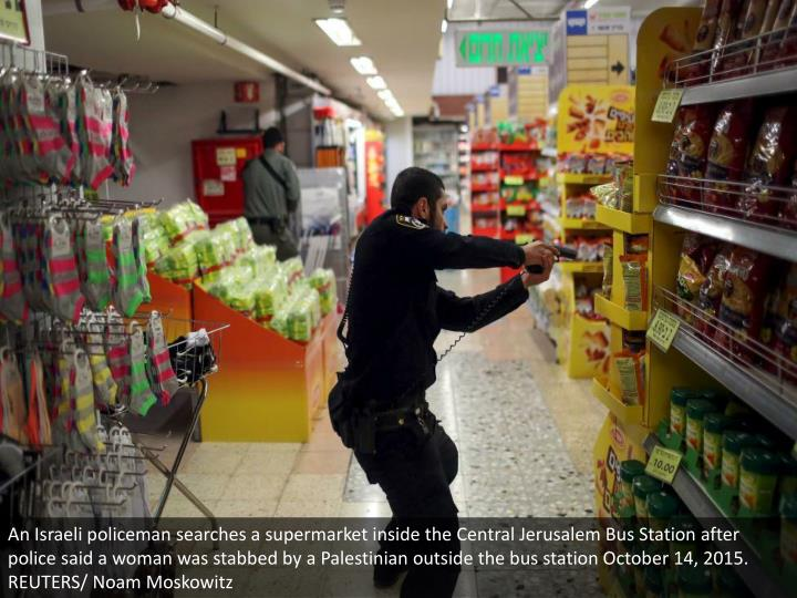 An Israeli policeman searches a supermarket inside the Central Jerusalem Bus Station after police said a woman was stabbed by a Palestinian outside the bus station October 14, 2015. REUTERS/ Noam Moskowitz