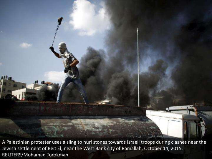 A Palestinian protester uses a sling to hurl stones towards Israeli troops during clashes near the Jewish settlement of Beit El, near the West Bank city of Ramallah, October 14, 2015. REUTERS/Mohamad Torokman