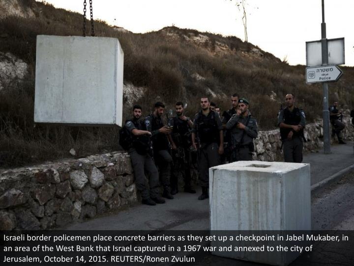 Israeli border policemen place concrete barriers as they set up a checkpoint in Jabel Mukaber, in an area of the West Bank that Israel captured in a 1967 war and annexed to the city of Jerusalem, October 14, 2015. REUTERS/Ronen Zvulun
