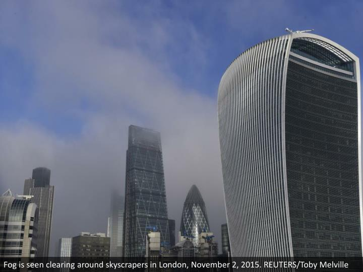 Fog is seen clearing around skyscrapers in London, November 2, 2015. REUTERS/Toby Melville