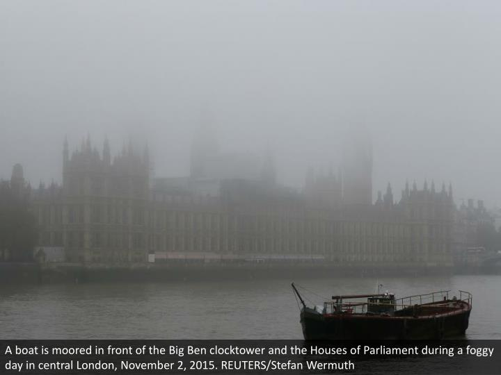 A boat is moored in front of the Big Ben clocktower and the Houses of Parliament during a foggy day in central London, November 2, 2015. REUTERS/Stefan Wermuth