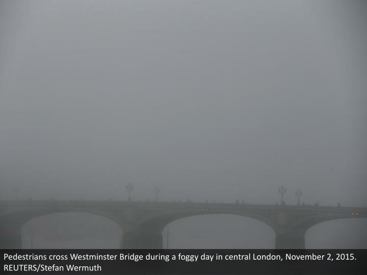 Pedestrians cross Westminster Bridge during a foggy day in central London, November 2, 2015. REUTERS/Stefan Wermuth